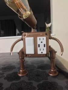 A vintage Edison light with usb and electrical outlet.